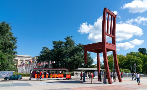 The giant chair with a broken leg stands in front of the Palace of Nations is a symbol of antipersonnel mines. Geneva, Switzerland.
