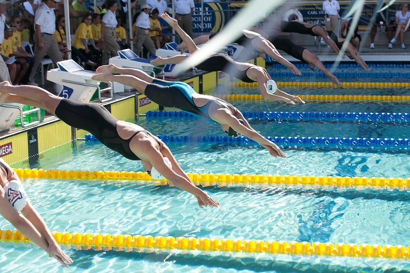women swimming in a competition. Amazing swimming facts